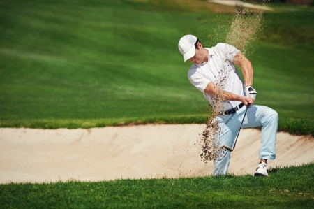 shot: golf shot from sand bunker golfer hitting ball from hazard