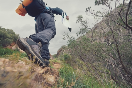 exlore: Adventure man with map in wilderness