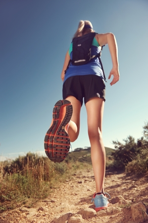 Trail running woman workout for healthy marathon fitness photo