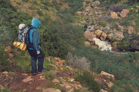 exlore: Adventure man hiking wilderness mountain with backpack, outdoor lifestyle survival vacation