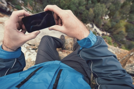 exlore: Adventure man with gps device or phone outdoors in wilderness exploring
