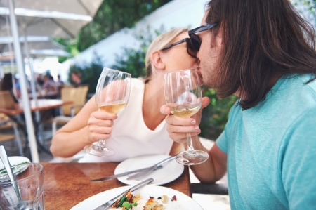 Couple kiss and celebrate engagement at lunch photo