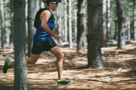 Trail running man exercising outdoors for fitness
