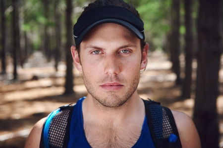 Serious portrait of marathon trail runner photo