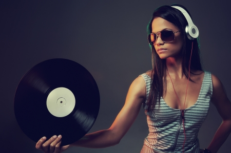Woman dj portrait with vinyl record and headphones Stok Fotoğraf