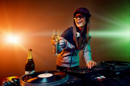 nightclub dj party with bubbly champagne and vinyl music playing photo