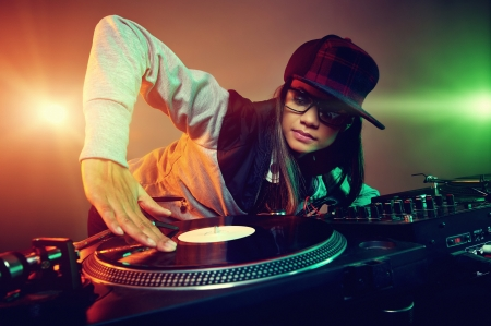Hiphop dj woman playing at nightclub party lifestyle photo