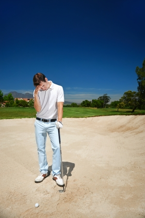 Golfer golf man having meltdown in bunker frustration Stock Photo