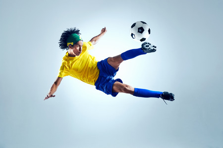 soccer kick: soccer football kick striker scoring goal with accurate shot for brazil team world cup