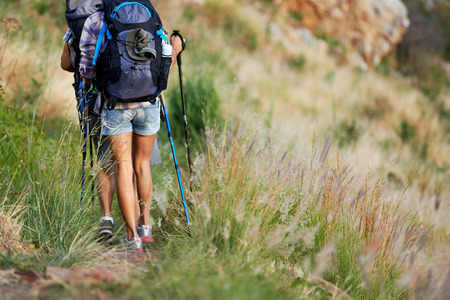 cropped image: Cropped image of a hiking couple walking along a hiking trail