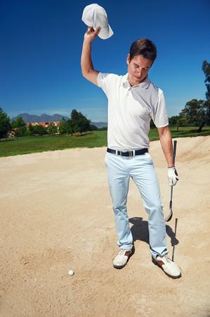 Golfer golf man having meltdown in bunker frustration Фото со стока