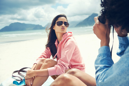 woman pouting for camera at the beach photo