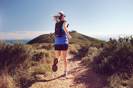 Trail running woman workout for healthy marathon fitness
