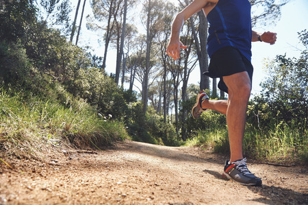 ultra: Trail running man exercising outdoors for fitness