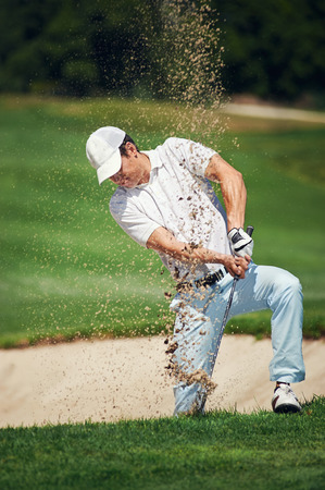 golf shot from sand bunker golfer hitting ball from hazard photo