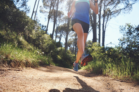 low angle view of trail runner exercising for marathon photo