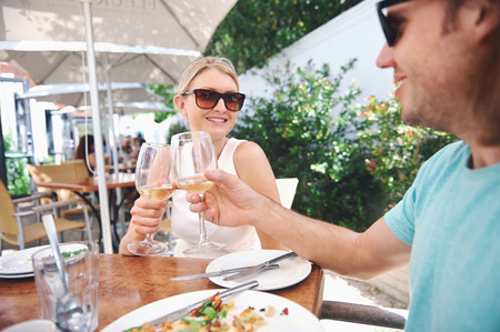 alfresco: Couple drinking white wine at lunch while on summer vacation Stock Photo