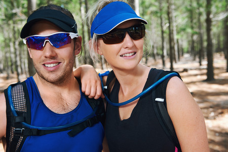 portrait of fit active healthy lifestyle trail runners photo