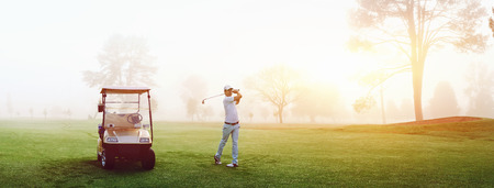golf green: Beautiful early morning golf game at the course in the sunrise and panoramic view Stock Photo