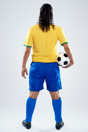 facing away: Brazil football player back view facing away full length in Brasil kit for world cup soccer Stock Photo