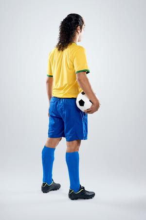 Brazil football player back view facing away full length in Brasil kit for world cup soccer photo