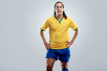 other world: confident portrait of football player in brasil uniform for brazil world cup soccer Stock Photo