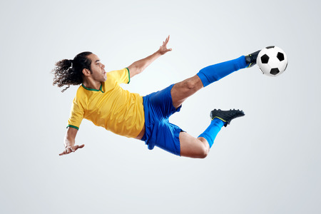 football world cup: soccer player kicking ball towards goal for score and glory in brazil world cup