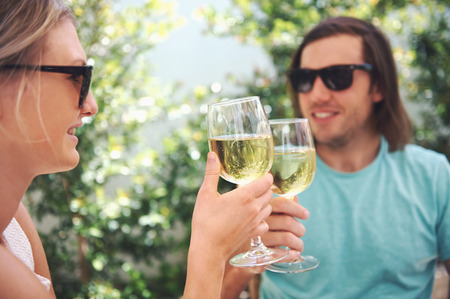 Couple drinking white wine at lunch while on summer vacation photo