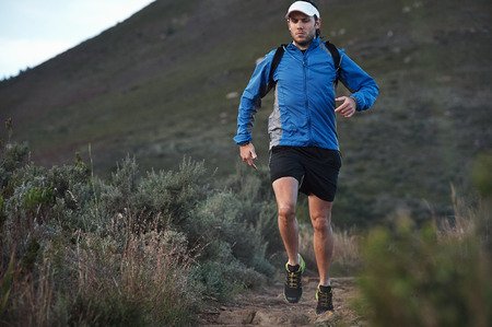 ultra marathon trail runner training in mountains for fitness and exercise photo