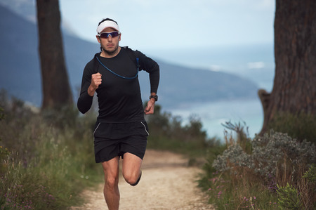 tough man: portrait of a trail runner exercising for fitness