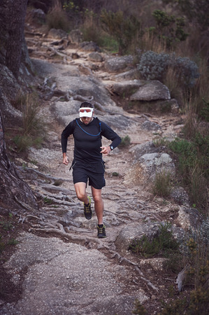mountain trail marathon running man training for fitness and healthy lifestyle photo