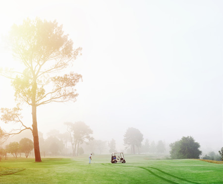 Beautiful early morning golf game at the course in the sunrise and panoramic view Stock Photo
