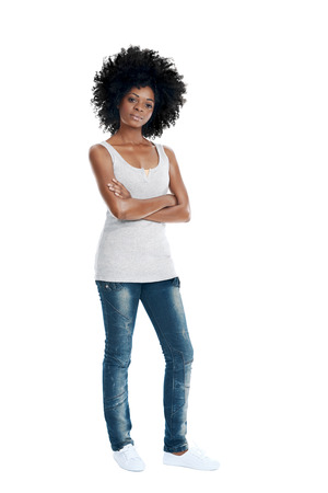 African woman with funky afro and casual clothing arms crossed in studio