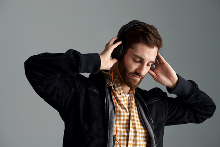 30436857: Man listening to music relaxing and enjoying good sound quality on professional dj headphones