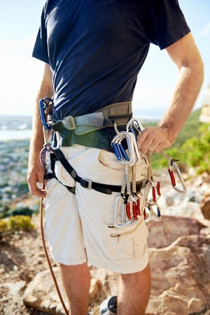 descender: Close up of a man in his harness and rockclimbing equipment Stock Photo