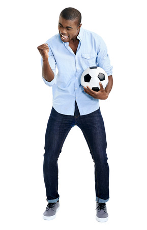 supporter: celebrating soccer fan with ball cheering in studio isolated on white