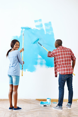 renovating: Fresh coat of paint on new apartment for young black african couple who have success and a home