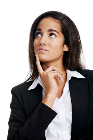 Thinking businesswoman with idea looking upward photo