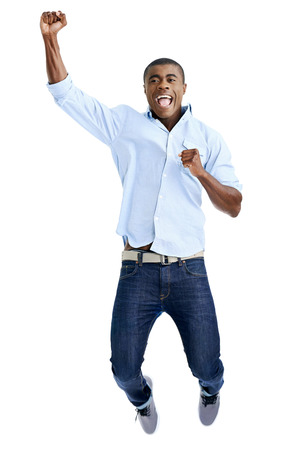 celebration jump of african man with arms out shouting photo