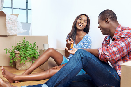 young black couple celebrating their new apartment and passing key