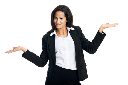 shrugs: woman confused in business and shrugs her shoulders Stock Photo
