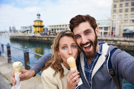 couple eating icecream taking selfie on holiday vacation travel