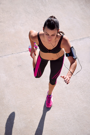 stride: active woman running workout view from above overhead as she jogs