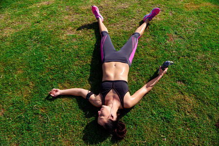 sweat girl: exhausted runner after fitness running workout catching breath Stock Photo