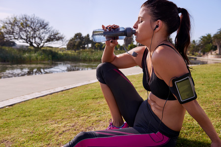 refreshment: fitness woman drinking water for refreshment after long run