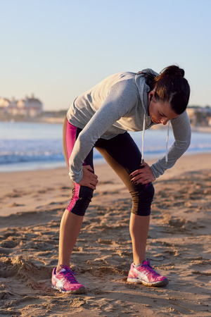 overheating: exhausted runner after fitness running workout catching breath Stock Photo