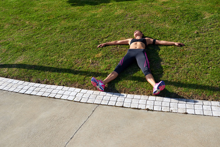 exhausted runner after fitness running workout catching breath Stock Photo