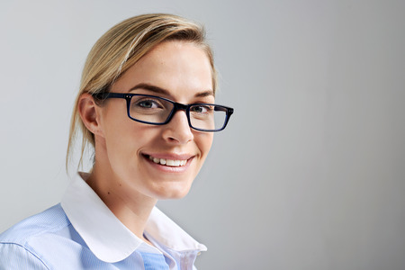 Portrait of a business intern woman with glasses smiling and happy Stock Photo