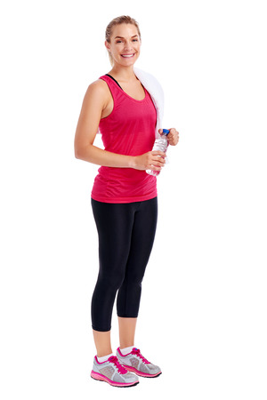 Woman getting ready for gym workout with towel and bottle water in studio photo