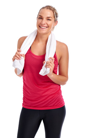 readiness: Woman getting ready for gym workout with towel in studio